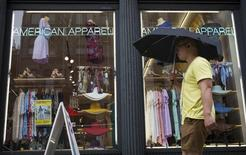 A man walks past an American Apparel store in New York June 19, 2014. REUTERS/Brendan McDermid