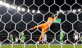 Algeria's goalkeeper Rais Mbolhi makes a save during the 2014 World Cup round of 16 game between Germany and Algeria at the Beira Rio stadium in Porto Alegre June 30, 2014.   REUTERS/Darren Staples