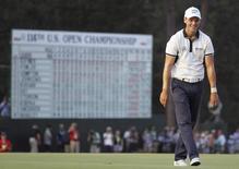 Martin Kaymer of Germany celebrates on the 18th green after winning the U.S. Open Championship golf tournament in Pinehurst, North Carolina, June 15, 2014. REUTERS/Robert Galbraith/Files