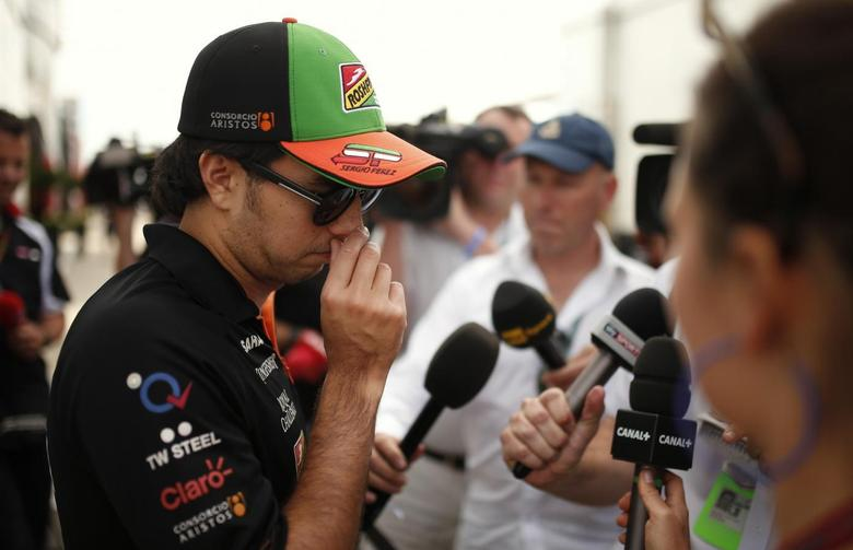 Force India Formula One driver Sergio Perez of Mexico talks to members of the media ahead of the British Grand Prix at the Silverstone Race Circuit, central England, July 3, 2014. REUTERS/Phil Noble