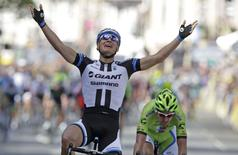 Giant-Shimano team rider Marcel Kittel of Germany celebrates as he wins the first 190.5 km stage of  the Tour de France cycling race from Leeds to Harrogate, July 5, 2014.   REUTERS/Jacky Naegelen