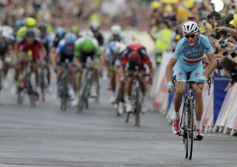 Astana team rider Vincenzo Nibali of Italy celebrates as he crosses the finish line to win  the second 201 km stage of  the Tour de France cycling race from York to Sheffield, July 6, 2014.       REUTERS/Jacky Naegelen