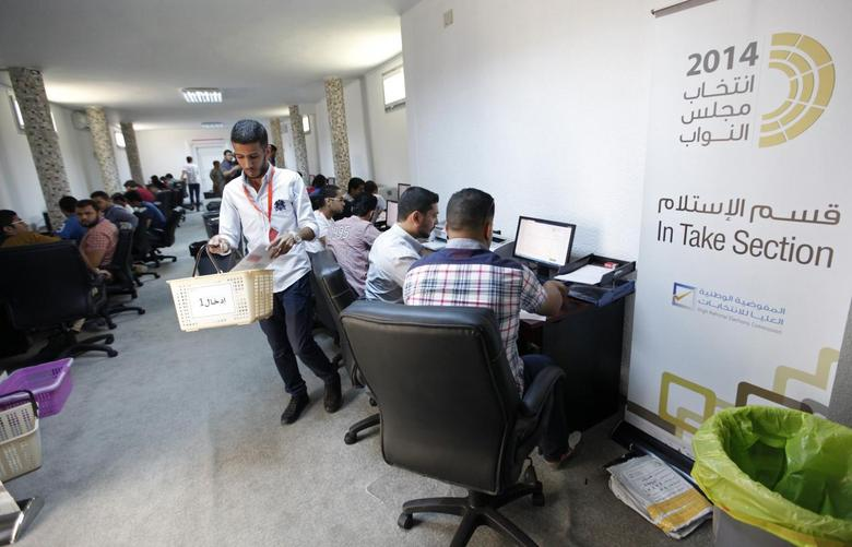 Election officials work in the operations rooms of the High National Elections Commission after elections yesterday in Tripoli, June 26, 2014.  REUTERS/Ismail Zitouny