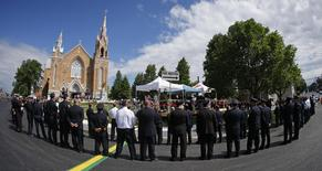 Emergency responders form an honor guard prior to a memorial mass at the Sainte-Agnes church in Lac-Megantic, July 6, 2014.  REUTERS/Mathieu Belanger
