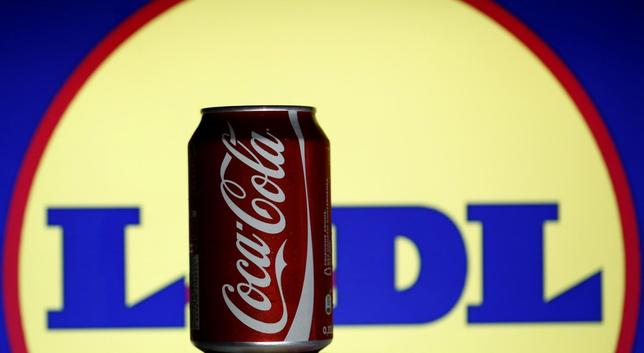 A can of Coca-Cola is seen in front of the logo of German multinational supermarket chain Lidl - shown on an LCD display behind - in this photo illustration taken in Sarajevo July 1, 2014. REUTERS/Dado Ruvic