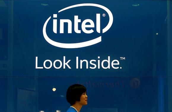 An employee walks past an Intel logo during the 2014 Computex exhibition at the TWTC Nangang exhibition hall in Taipei June 3, 2014. REUTERS/Pichi Chuang