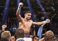 Amir Khan of Britain celebrates his victory over Luis Collazo of the U.S. after their welterweight fight at the MGM Grand Garden Arena in Las Vegas, Nevada, May 3, 2014. REUTERS/Steve Marcus
