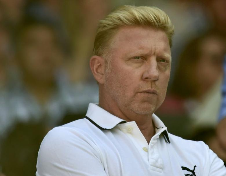 Boris Becker, the coach of Novak Djokovic of Serbia, sits on Centre Court for the men's singles semi-final tennis match between Djokovic and Grigor Dimitrov of Bulgaria at the Wimbledon Tennis Championships, in London July 4, 2014.      REUTERS/Toby Melville