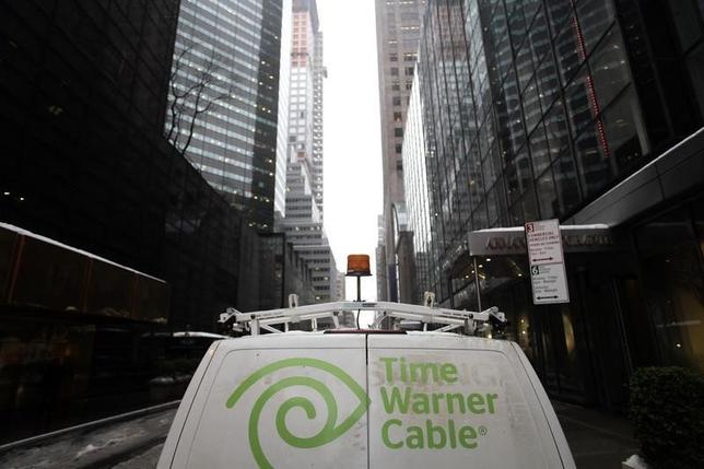 The Time Warner Cable logo is displayed on the back of a van in New York February 13, 2014.  REUTERS/Joshua Lott