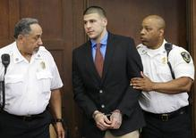 Former New England Patriots star Aaron Hernandez (C) is escorted by court officers as he enters Suffolk Superior Court before a hearing in Boston, Massachusetts, June 24, 2014. REUTERS/Steven Senne/Pool