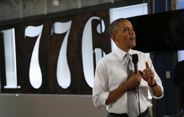 U.S. President Barack Obama speaks about the job numbers and the economy during a visit to 1776, a tech startup hub, in Washington July 3, 2014. U.S. employment growth jumped in June and the jobless rate closed in on a six-year low, decisive evidence the economy was moving forward at a brisk clip after a surprisingly big slump at the start of the year. REUTERS/Kevin Lamarque  (UNITED STATES - Tags: POLITICS BUSINESS EMPLOYMENT SCIENCE TECHNOLOGY)