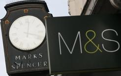 Marks & Spencer signs are seen outside outside a store in London January 8, 2014.   REUTERS/Stefan Wermuth