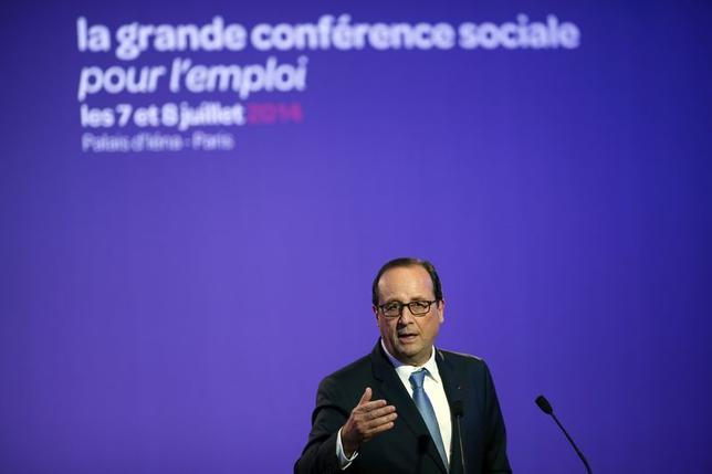 French President Francois Hollande delivers his speech at the Social Conference, a 2-day conference to discuss economic reform plans with unions and workers in Paris, July 7, 2014.    REUTERS/Benoit Tessier