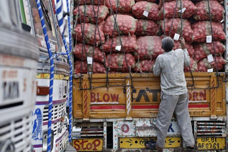 A labourer prepares to unload sacks of potatoes from a truck at a wholesale vegetable and fruit market in New Delhi July 2, 2014. REUTERS/Anindito Mukherjee