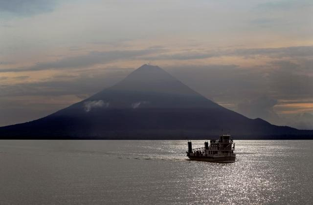 A ferry boat crosses Cocibolca Lake with the Concepcion Volcano in the background at Ometepe Island May 22, 2012. REUTER/Oswaldo Rivas