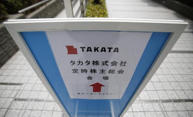 A sign board of Japanese auto parts maker Takata Corp's Annual General Meeting is seen on a street near the venue in Tokyo June 26, 2014.  REUTERS/Yuya Shino