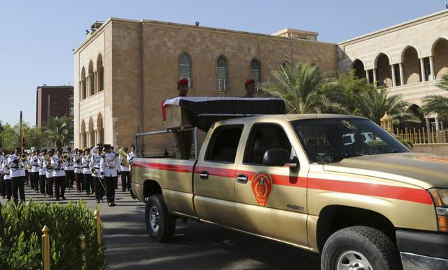 A military vehicle transports the coffin of Major General Negm Abdullah Ali, commander of the army's sixth division, during a funeral ceremony at the defence ministry in Baghdad July 7, 2014. REUTERS/Stringer