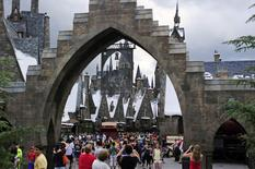 Guests walk in and out of Hogsmeade Village during a media preview for The Wizarding World of Harry Potter-Diagon Alley at the Universal Orlando Resort in Orlando, Florida June 19, 2014. REUTERS/David Manning