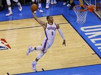 Oklahoma City Thunder guard Russell Westbrook (0) goes up for a dunk against the San Antonio Spurs in game three of the Western Conference Finals of the 2014 NBA Playoffs at Chesapeake Energy Arena. Oklahoma City won 106-97. Mandatory Credit: Alonzo Adams-USA TODAY Sports