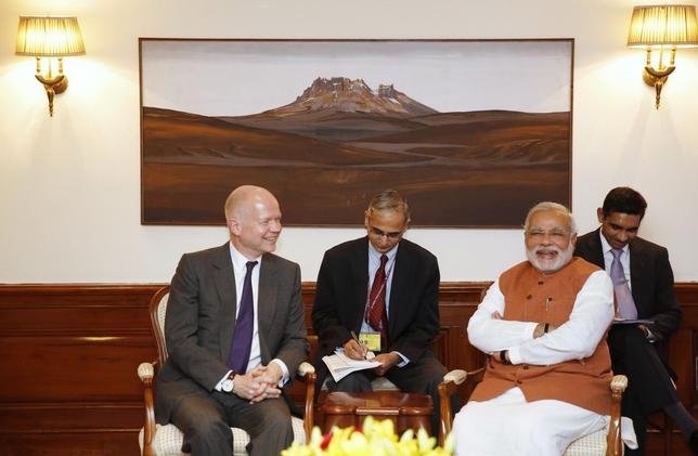 Britain's Foreign Secretary William Hague (L) and Indian Prime Minister Narendra Modi (2nd R) smile during their meeting in New Delhi July 8, 2014. REUTERS/Manish Swarup/Pool