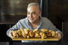 "Chef Lee Brian Schrager, author of ""Fried & True"" and founder of the Food Network South Beach and New York City Wine & Food Festivals, holds a board of fried chicken at Holeman & Finch in Atlanta, Georgia, in 2013. REUTERS/Random House/Evan Sung/Handout via Reuters"