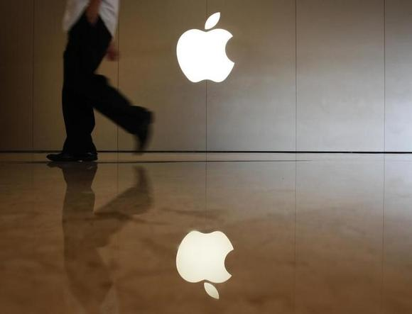 A man walks past the logo at an Apple store in the southern Chinese city of Shenzhen, neighbouring Hong Kong September 9, 2013. REUTERS/Bobby Yip/Files