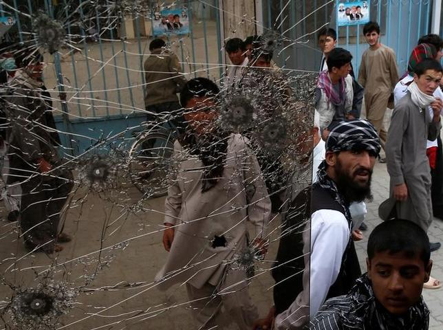 People look at a cracked side window of a bus which was damaged at bomb blasts in Kabul June 6, 2014. AbREUTERS/Ahmad Masood