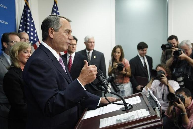 U.S. House Speaker John Boehner (R-OH) (front L) gestures as he addresses reporters during a news conference at the U.S. Capitol in Washington, October 4, 2013. REUTERS/Jonathan Ernst