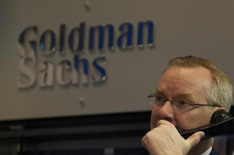 Goldman Sachs trader Dennis Maguire works in his company's stall on the floor of the New York Stock Exchange January 15, 2014.  REUTERS/Brendan McDermid