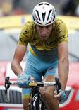 Astana team rider Vincenzo Nibali of Italy crosses the finish line of the 155.5 km fifth stage of the Tour de France cycling race from Ypres Belgium to Arenberg Porte du Hainaut July 9, 2014.  REUTERS/Jacky Naegelen