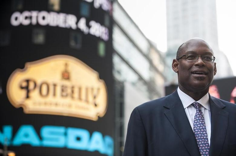 Potbelly Corporation Chief Executive Aylwin Lewis speaks during an interview after the company's IPO at the Nasdaq Market site in New York October 4, 2013.  REUTERS/Keith Bedford