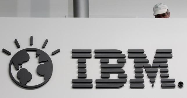 A worker is pictured behind a logo at the IBM stand on the CeBIT computer fair in Hanover February 26, 2011. REUTERS/Tobias Schwarz /Files