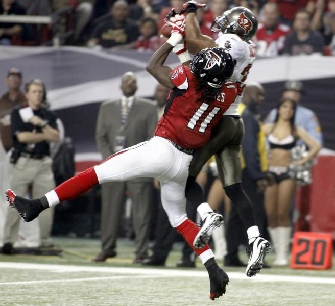 Atlanta Falcons wide receiver Julio Jones (11) battles Tampa Bay Buccaneers safety Tanard Jackson (36) for a pass before scoring a touchdown after the catch in the first half of their NFL football game in Atlanta, Georgia January 1, 2012. REUTERS/Tami Chappell