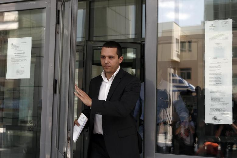 Lawmaker from the Golden Dawn far-right party Ilias Kasidiaris leaves a court building in Athens July 3, 2014. REUTERS/Yorgos Karahalis