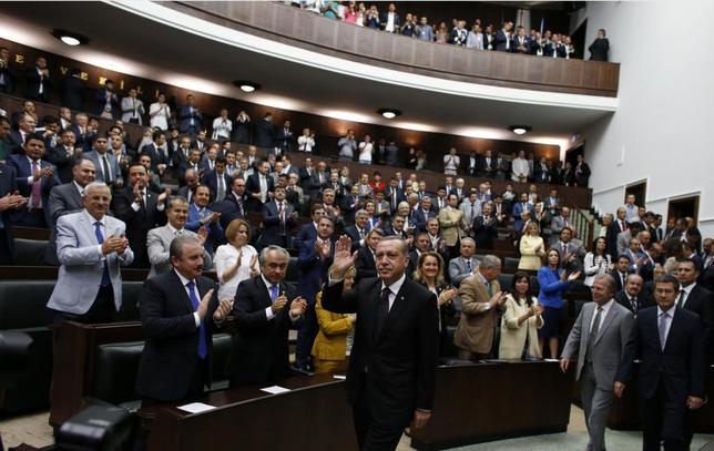 Turkey's Prime Minister Tayyip Erdogan greets members of parliament from his ruling AK Party (AKP), as he arrives for a meeting at the Turkish parliament in Ankara July 8, 2014. REUTERS/Umit Bektas