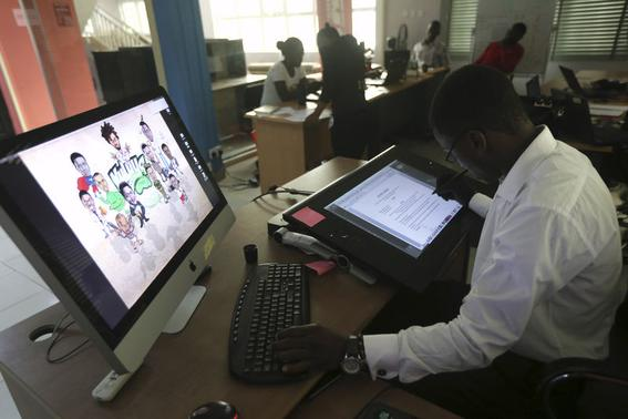 An illustrator works on a digital drawing board at the Kuluya Games office at Anthony district in Nigeria's commercial capital of Lagos June 16, 2014. REUTERS/Akintunde Akinleye/Files