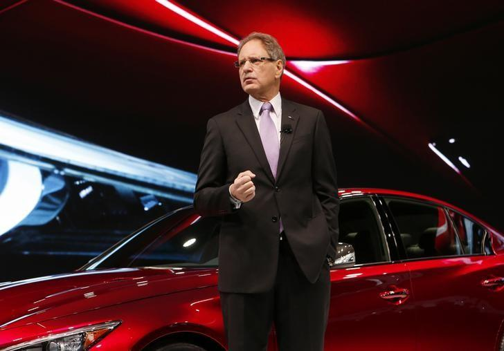 Johan de Nysschen, President, Infiniti Motor Company Ltd., speaks next to a Q 50 Eau Rouge sedan after it was unveiled during the press preview day of the North American International Auto Show in Detroit, Michigan January 14, 2014.        REUTERS/Rebecca Cook