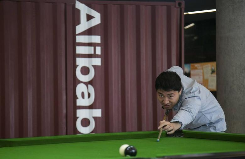 A man plays snooker in a hall inside Alibaba's headquarters in Hangzhou, Zhejiang province, April 23, 2014. REUTERS/Chance Chan/Files
