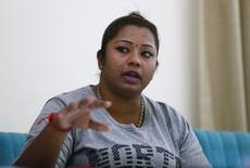 Deepa Subramaniam, 30, speaks during an interview in Petaling Jaya, near Kuala Lumpur July 3, 2014. REUTERS/Samsul Said