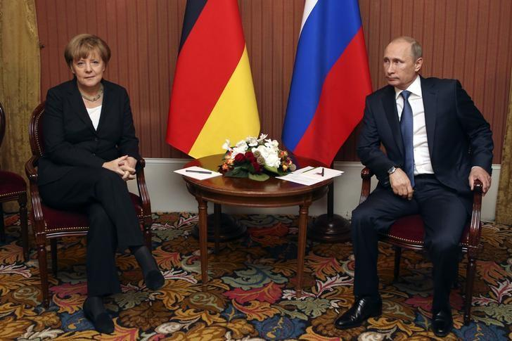 Russian President Vladimir Putin meets with German Chancellor Angela Merkel in Deauville, Northern France June 6, 2014. REUTERS/Sergei Karpukhin