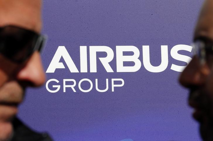 Visitors walk past the logo of Airbus Group during the e-Aircraft Day at the Bordeaux Merignac airport, southwestern France, April 25, 2014.   REUTERS/Regis Duvignau