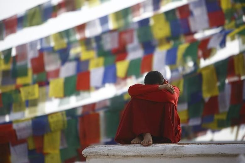 A monk rests at the premises of Boudhanath Stupa in Kathmandu March 10, 2014. REUTERS/Navesh Chitrakar
