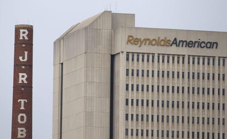The headquarters of Reynolds American is seen next to the old R.J. Reynolds Tobacco smoke stacks in downtown Winston-Salem, North Carolina in this file photo taken May 23, 2014.   REUTERS/Chris Keane/Files