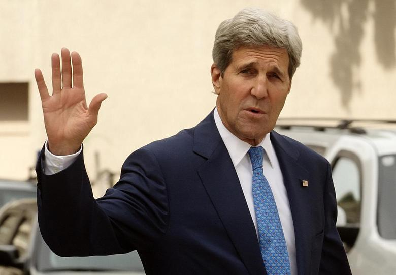 U.S. Secretary of State John Kerry waves to journalists as he walks to a meeting on the second straight day of talks over Tehran's nuclear program at a hotel in Vienna July 14, 2014 file photo.  REUTERS/Heinz-Peter Bader