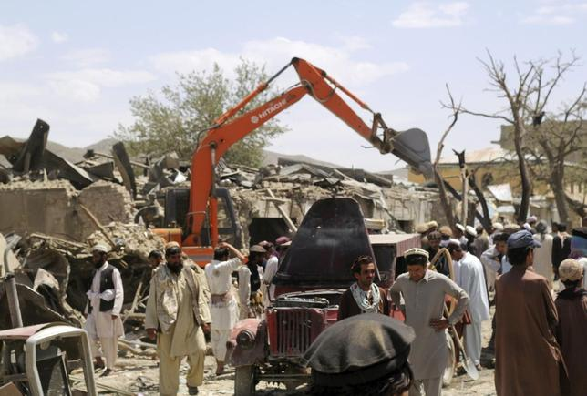 Villagers gather at the site of a car bomb attack in Urgon district eastern province of Paktika July 15, 2014. REUTERS/Stringer