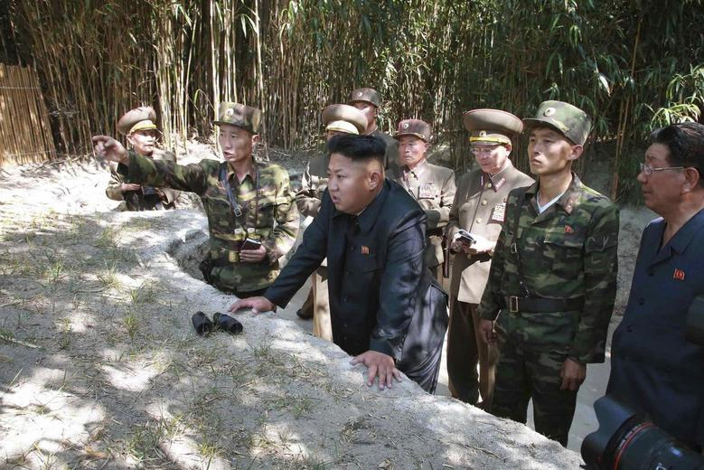 North Korean leader Kim Jong Un inspects a civil police post under KPA Unit 171 and a post of the third company of the second battalion under the unit guarding the forefront in this undated photo released by North Korea's Korean Central News Agency (KCNA) in Pyongyang July 15, 2014. REUTERS/KCNA