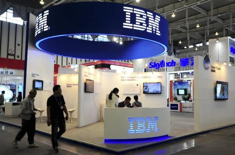 Visitors walk past the IBM booth at the 9th China International Software Product & Information Service Expo in Nanjing, Jiangsu province September 6, 2013. REUTERS/China Daily/Files