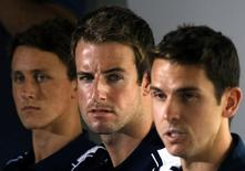Eamon Sullivan (R)  sits with James Magnussen (C) and teammates Cameron McEvoy (L) from Australia's 4x100m freestyle relay team at the London Olympic Games during a media conference at a hotel in Sydney February 22, 2013. REUTERS/David Gray