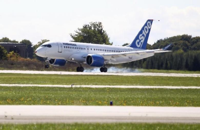 Bombardier's CSeries aircraft lands after its first test flight in Mirabel, Quebec September 16, 2013.REUTERS/Christinne Muschi