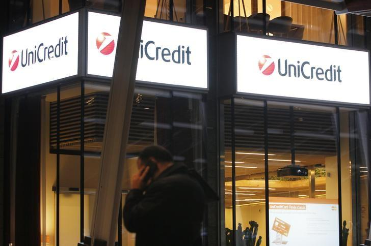 A man talks on the phone outside the UniCredit Bank headquarters in Milan March 11, 2014. REUTERS/Alessandro Garofalo